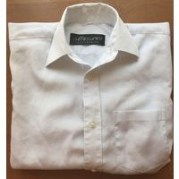 Детская новая светящаяся белая с фиолетовым отливом рубашка с большим карманом на груди и двумя гладкими пуговицами на запястьях для их регулирования для мальчика от 7 до 11 лет