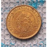 Уругвай 1 доллар 2012 года. MULITA. Герб. Инвестируй выгодно в монеты планеты!