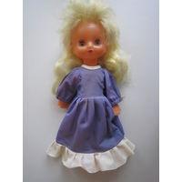 Кукла. Пластмасса. Руки, ноги, голова на резинке. 33 см.