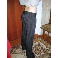 Красивые офисные брюки в полосочку р.46