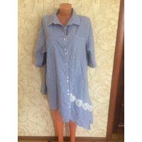 Стильная рубашка от Darkwin на 54-58 размер, можно даже и больше. Очень стильная рубашка, отлично смотрится с джинсами, брюками, также и с юбками. Насыщенно голубой цвет в белую полоску.