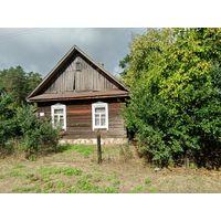 Крепкий дом-сруб в Дзержинском р-не 55 км от МКАД (поворот на Узду), Негорельский с/с д.Скородное. До станции электрички Асино менее 2 км.Всю деревню окружают грибные леса, лесное озеро Асинское 2 км