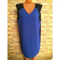 Шикарное стильное платье на пышную красавицу 54 размера. Спереди насыщенно васильковый цвет, сзади черного цвета. Длина 98 см, ПОгруди 60 см. Отличное состояние.
