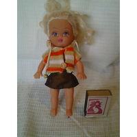 Куколка небольшая. Современная.