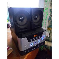 Микро аудио система Rolsen RMD-100 12 Вт DVD неисправная.