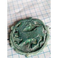 Старинная накладка с изображением зверя