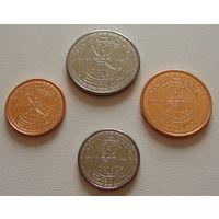 Оман.  набор 4 монеты 5,10,25, 50 байса 2015 год
