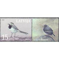 Латвия фауна птица марка с полем
