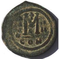ВИЗАНТИЯ. МАВРИКИЙ ТИБЕРИЙ (582-602 г.) КОНСТАНТИНОПОЛЬ. 586 г. КРУПНЫЙ ФОЛЛИС 29-31 мм.