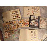 Коллекция марок значков монет и пластинок
