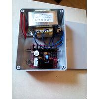 Блок питания SECO-LARM ST-2406-2A / источник питания для приборов видеонаблюдения, сигнализации и контроля доступа.