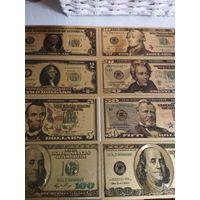 Набор золотых долларов.
