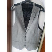 Новая костюмная жилетка из 100% шерсти