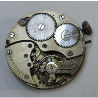 Механизм от карманных часов Longines до 1917 г. Диаметр 3.7 см. Не исправный.