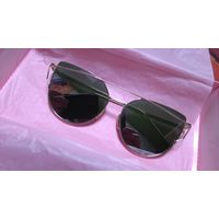 Солнцезащитные очкиг