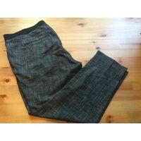 Стильные брюки на 54-56 размер, красивый серо-черный штрих, очень здорово смотрятся на фигурке. Состав: полиэстер вискоза и эластан. Надела буквально пару раз, великоваты. Длина 93 см, ПОталии 52-58 с
