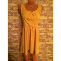 Красивое и стильное горчично-желтое платье фирмы SLN на 42 размер, очень интересный покрой. Длина 80 впереди, ПОталии 36 см. Обмен не интересует