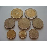 Ливия.  набор из 8 монет 1,5,10,20,50,100 дирхам 1/2,1/4 динара 1979-2004 год