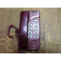 Телефон кнопочный.