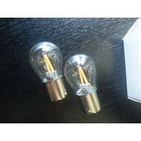Лампа светодиодная тип P21W 12V (2 шт). Выполнена на филаментных светодиодных нитях. Напряжение 12 V, цвет свечения теплый белый (желтоватый). Количество ламп 2 шт.